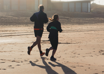 Couple Running Beach